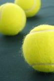 Three yellow tennis ball  on green Royalty Free Stock Image