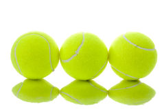 Three yellow tennis balls Royalty Free Stock Photos