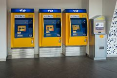 Three yellow ticket machines at Dutch railway station royalty free stock images