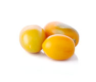 Three yellow tomatoes Royalty Free Stock Image