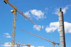 Three Yellow Tower Cranes Against A Clouded Skyline Royalty Free Stock Image