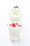 Three yogurt with fruit in a glass beaker on a white background Royalty Free Stock Images