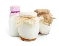 Three yogurts on white background Royalty Free Stock Images