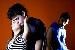 Three Young Adults in Conflict stock photos