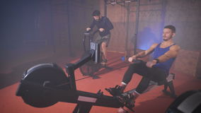 Three young athletes doing exercises on training apparatus. Three young athletes doing exercises on training apparatus at the same time. Friends after a hard stock footage