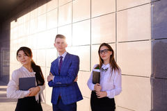 Three young attractive educated young businessman smiling, holdi Stock Images