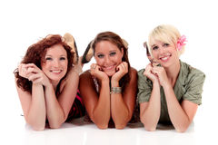 Three young attractive women Stock Images