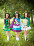 Three young beautiful girls in irish dance dress posing outdoor Royalty Free Stock Images