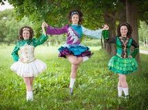 Three young beautiful girls in irish dance dress posing outdoor Royalty Free Stock Photos