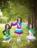 Three young beautiful girls in irish dance dress posing outdoor Royalty Free Stock Photo