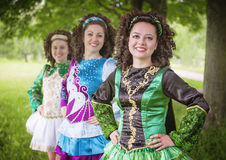 Three young beautiful girls in irish dance dress posing outdoor Stock Photos