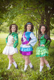 Three young beautiful girls in irish dance dress posing outdoor Stock Photography