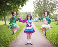 Three young beautiful girls in irish dance dress posing outdoor Royalty Free Stock Image