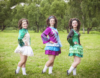 Three young beautiful girls in irish dance dress posing outdoor Royalty Free Stock Image