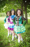 Three young beautiful girls in irish dance dress posing outdoor Royalty Free Stock Photo