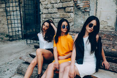 Three young beautiful girls. Posing against the backdrop of an abandoned building Stock Images