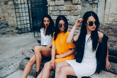 Three young beautiful girls. Posing against the backdrop of an abandoned building Royalty Free Stock Photos