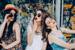 Three young beautiful girls. Rest at a bus stop Stock Image