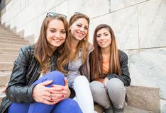 Three young beautiful girls smiling Stock Images