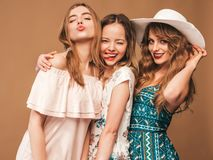 Three Young Beautiful Hipster Girls In Trendy Clothes In Studio Stock Photo