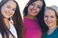 Three young beautiful woman on the  sky background Stock Image