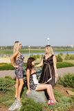 Three young beautiful woman on a summer day Royalty Free Stock Image