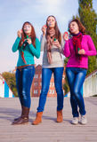 Three young beautiful women blow bubbles Stock Images