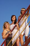 Three young beautiful women  on a stair Royalty Free Stock Image