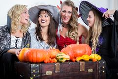 Three beautiful women acting as witches joining their malicious Royalty Free Stock Photography