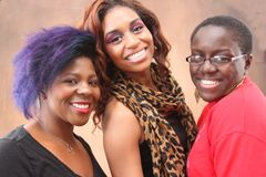 Three young black women together smiling Stock Image