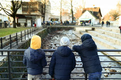 Three young boys on a bridge Royalty Free Stock Photography