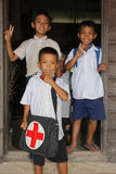Three young boys pose at school Stock Photography