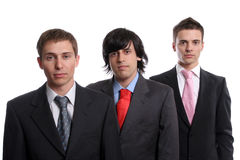 Three young business man isolated. On white background - focus on the man in the center stock photos