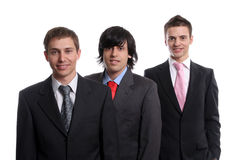 Three young business men isolated. On white background - focus on the man in the center royalty free stock images