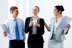 Three young business people laughing Royalty Free Stock Photo