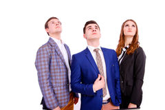 Three young business people looking up Royalty Free Stock Photography