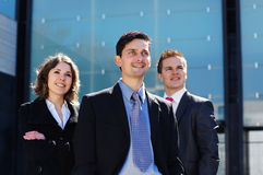 Three young business persons in formal clothes Royalty Free Stock Photography
