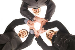 Three young business persons in a group handshake Stock Photos