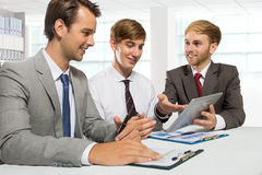Three young businessman discussion about a work project, isolate Royalty Free Stock Photo