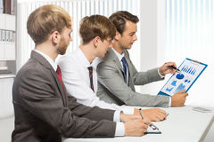 Three young businessman discussion about a work project, isolate Royalty Free Stock Photos