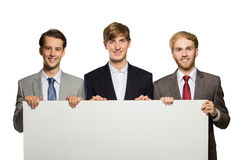 Three young businessman standing with a blank whiteboard , isola Stock Photo
