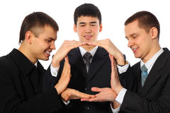 Three young businessmen do house from palms Royalty Free Stock Photos