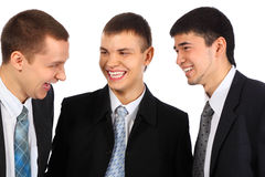 Three young businessmen laugh Royalty Free Stock Images
