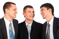 Three young businessmen laugh Stock Image