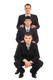 Three young businessmen one after another Stock Photos