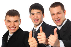Three young businessmen show gesture ok Stock Photo