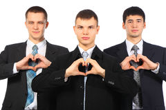 Three Young Businessmen Show Love Sign From Hands Royalty Free Stock Images
