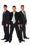 Three young businessmen stand semicircle Royalty Free Stock Photography