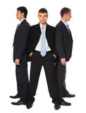 Three young businessmen stand semicircle Stock Image