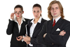 Three young businesspeople. Group of three businesspeople, man with two women, isolated on white background Stock Photo